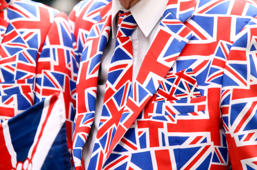 A pedestrian wears a suit, featuring the pattern of a British Union flag, commonly known as a Union Jack, in London, U.K., on Friday, June 10, 2016. U.K. Prime Minister David Cameron said he'll hold a long-pledged referendum on the U.K.'s membership of the European Union on June 23.