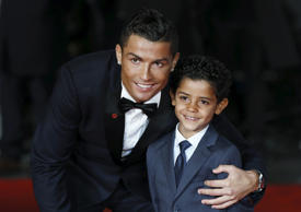 "Soccer player Cristiano Ronaldo and his son Cristiano Ronaldo Jr. pose for photographers on the red carpet at the world premiere of ""Ronaldo"" at Leicester Square in London, Britain November 9, 2015. REUTERS/Stefan"