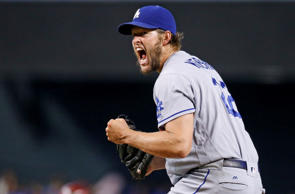 Los Angeles Dodgers' Clayton Kershaw shouts and pumps his fist after striking ou...