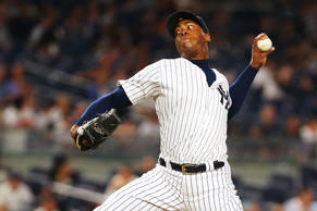 Aroldis Chapman #54 of the New York Yankees pitches in the ninth inning against the Minnesota Twins at Yankee Stadium on June 24, in the Bronx borough of New York City.