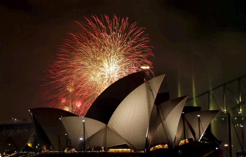 Fireworks explode over the Sydney Opera House and Harbour Bridge as Australia's largest city ushers in the New Year, January 1, 2016.