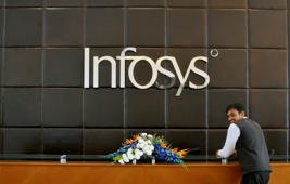 File: An employee of Infosys stands at the front desk of its headquarters in Bengaluru, India, April 15, 2016.