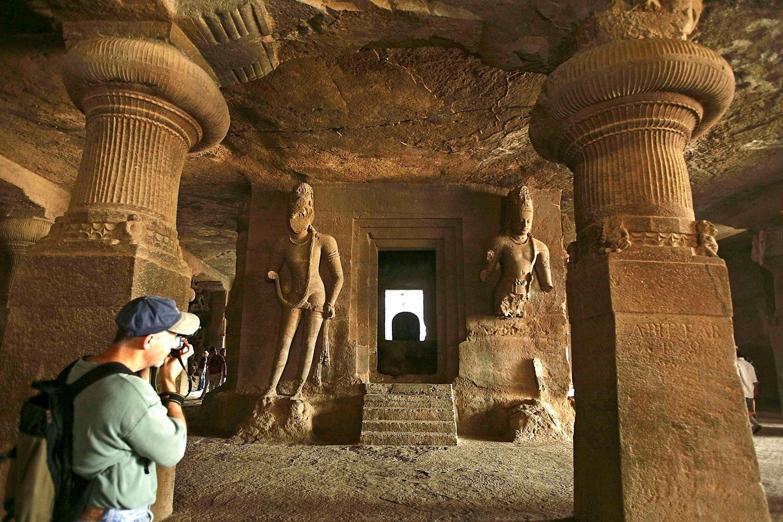A tourist takes photos at a cave temple on Elephanta island near Mumbai January 21, 2007.