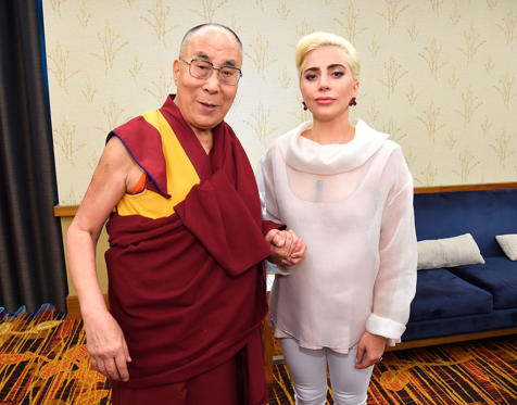 INDIANAPOLIS, IN - JUNE 26: (Exclusive Coverage) Lady Gaga (R) joins his Holiness the Dalai Lama (L) to speak to US Mayors about kindness at JW Marriott on June 26, 2016 in Indianapolis, Indiana.