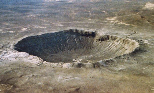 UNITED STATES - JULY 18: Meteor Crater is one of the youngest and best-preserved impact craters on Earth. The crater formed roughly 50,000 years ago when a 30-meter-wide, iron-rich meteor weighing 100,000 tons struck the Arizona desert at an estimated 2