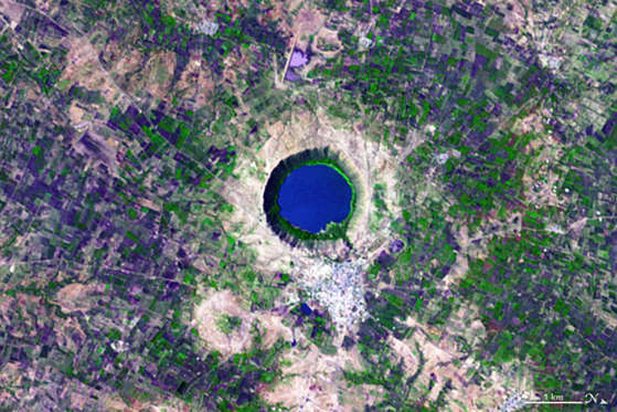 NASA reveals entire alphabet in satellite images - Dec 2015 Letter Q - On November 29, 2004, the Advanced Spaceborne Thermal Emission and Reflection Radiometer (ASTER) on NASA's Terra satellite acquired this image of Lonar Crater in India. Shocked quartz