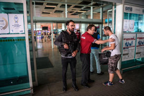 A Turkish anti riot police officer, left, and an employee of a private security ...