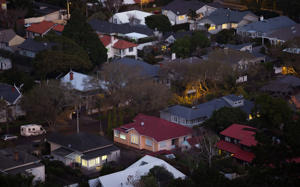 Houses stand in the suburb of Mount Eden at dusk in Auckland, New Zealand