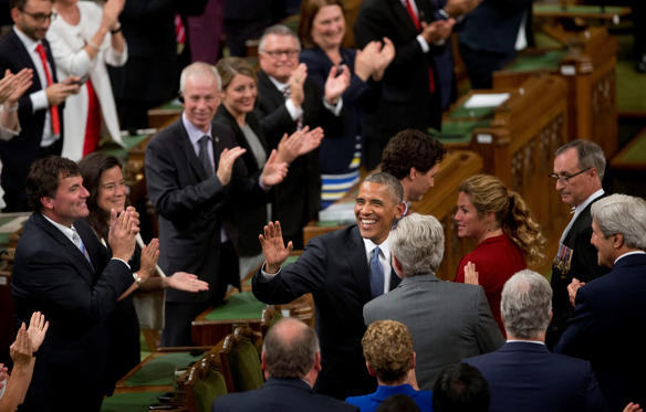 Slide 1 of 30: President Barack Obama waves as he arrives to address the Canadian Parliament in the House of Commons in Ottawa, Canada, Wednesday, June 29, 2016. With Obama are Canadian Prime Minister Justin Trudeau, behind Obama, and his wife Sophie Gregoire Trudeau.