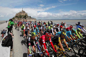 Cycling - The Tour de France cycling race - The 188-km (117 miles) 1st stage from Mont Saint-Michel to Utah Beach Sainte-Marie-du-Mont - 02/07/2016 - The pack of riders take the start from the Mont Saint-Michel. REUTERS/Juan