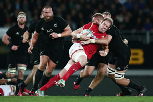 Alun Wyn Jones of Wales chares into Luke Romano of New Zealand during the International Test match between the New Zealand All Blacks and Wales at Eden Park on June 11, 2016 in Auckland, New Zealand.