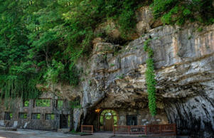 Located in Parthenon, Arkansas, this Flintstones-style home is built into a cave, and has been purposely renovated in a way to keep the features of the cave and its authenticity.
