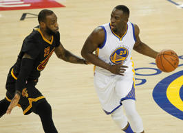 Golden State Warriors forward Draymond Green (23) moves the ball against Cleveland Cavaliers forward LeBron James (23) in the first half in game seven of the NBA Finals at Oracle Arena.