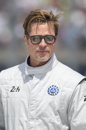 Brad Pitt poses for photographs, prior to starting the 84th 24-hour Le Mans endurance race, in Le Mans, western France, Saturday, June 18, 2016.