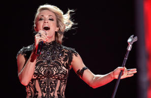 "FILE - In this June 8, 2016, file photo, Carrie Underwood performs ""Church Bells..."