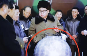 "A TV screen showing North Korean leader Kim Jong Un with superimposed letters that read: ""North Korea's nuclear warhead"" during a South Korea news broadcast in March."