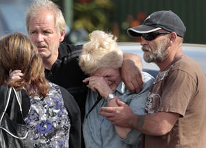 Family members of miners trapped underground in the Pike River coal mine react after learning of a second explosion in the mine at a briefing by mine authorities and police in Greymouth on New Zealand's west coast November 24, 2010. All 29 miners trapped