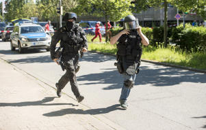 Heavily-armed police outside a movie theatre complex where an armed man has reportedly opened fire on June 23, 2016 in Viernheim, Germany. According to initial media reports, the man entered the cinema today at approximately 3pm, fired a shot in the air and barricaded himself inside