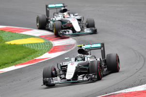 Mercedes driver Nico Rosberg of Germany steers his car in front of Mercedes driver Lewis Hamilton of Britain during the Formula One Grand Prix