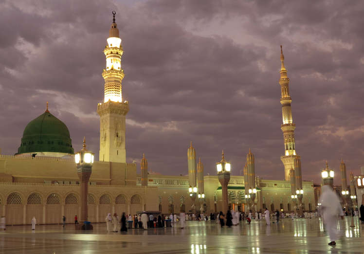 FILE -- In this July 5, 2013 file photo, worshippers visit the Prophet's Mosque in Medina, Saudi Arabia. State-linked Saudi news websites reported an explosion has gone off outside the Prophet's Mosque, one of Islam's holiest sites in the city of Medina