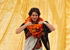 File: Priyanka Gandhi Vadra, daughter of India's ruling Congress party chief Sonia Gandhi, adjusts her flower garlands as she campaigns for her mother during an election meeting at Rae Bareli in the northern Indian state of Uttar Pradesh April 22, 2014.
