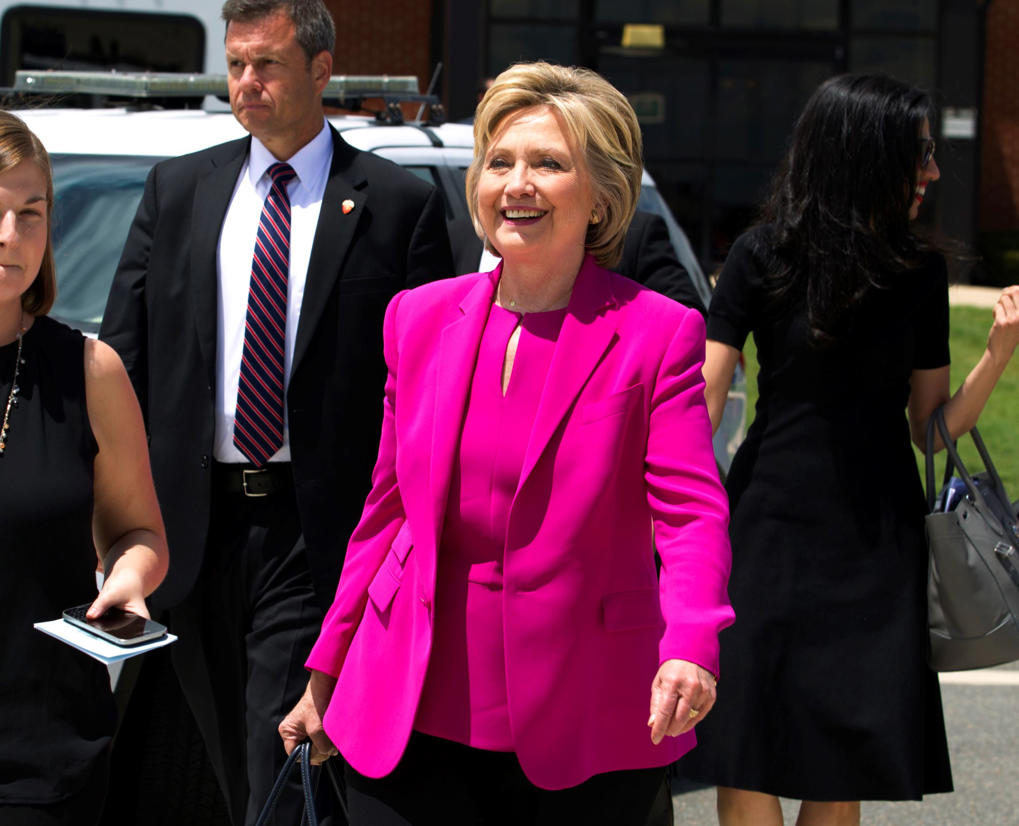 Democratic presidential candidate Hillary Clinton, followed by aide Huma Abedin, right, walks on the tarmac as she arrives to board Air Force One at Andrews Air Force Base, Md., Tuesday, July 5, 2016.