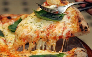 An occasional pizza can help dieters lose weight a study has suggested