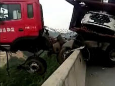 Lorry hangs at edge of bridge