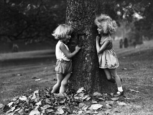 Slide 2 of 28: 15th October 1931:  Daphne and Tony Beacon play a game of hide-and-seek in Hyde Park, London.  (Photo by Fox Photos/Getty Images)