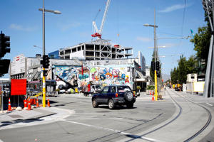 A vehicle is driven past a construction zone in Christchurch, New Zealand