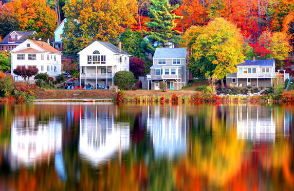 Slide 1 of 27: Beautiful autumn reflection on a small pond in Boston's Brighton neighborhood. Boston is the largest city in New England, the capital of the state of Massachusetts. Boston is known for its central role in American history,world-class educational institutions, cultural facilities, and champion sports franchises.