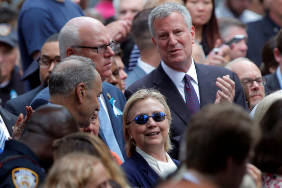 Hillary Clinton and New York Mayor Bill de Blasio attend the ceremonies.
