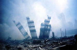10/10 US-ATTACKS-2ND YEAR ANNIVERSARY The rubble of the World Trade Center smoulders following a terrorist attack 11 September 2001 in New York. A hijacked plane crashed into and destroyed the landmark structure. The all-out war on terrorism unleashed by Washington after the attacks marked a turning point in US-Arab relations and nowhere more so than in once top ally Saudi Arabia. With 15 of the 19 suicide hijackers carrying Saudi nationality and mastermind Osama bin Laden being the scion of a leading Saudi family, the desert kingdom and world oil kingpin, suddenly found itself on the frontline of the war on terror prosecuted by US President George W. Bush. AFP PHOTO/Alex Fuchs (Photo credit should read ALEX FUCHS/AFP/Getty Images)