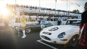 Remove the modern sponsor logos and this could pass as a photo taken in the 1960s. A grid girl is flanked by a pair of Jaguar E-Types.
