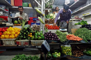 Vegetable vendors wait for customers at a market in Mumbai