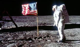060280 01: Astronaut Edwin 'Buzz' Aldrin poses next to the U.S. flag July 20, 1969 on the moon during the Apollo 11 mission. (Photo by NASA/Liaison)
