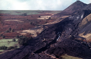 The moving mountain of coal sludge after the disaster at Aberfan when the coal tip avalanched through the Pantglas Junior School, killing 116 children and 28 adults.
