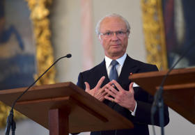 King Carl XVI Gustaf of Sweden addresses the press at the start of his visit to Riga, Latvia on March 26, 2014. The King together with his wife Queen Silvia are in Latvia for a two day visit. AFP PHOTO / ILMARS ZNOTINS        (Photo credit should read IL