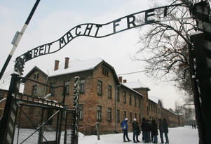 Tourists over the entrance to the former Nazi death camp Auschwitz-Birkenau, in Oswiecim, Poland