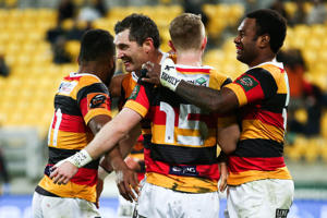 Sevu Reece, Stephen Donald, Jordan Trainor and Iliesa Ratuva Tavuyara of Waikato celebrate the win after the final whistle during the round nine Mitre 10 Cup match between Wellington and Waikato at Westpac Stadium.