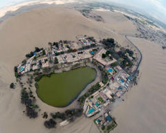 Aerial view of the Huacachina Oasis in Ica, Peru, some 300 km south of Lima on December 11, 2014, one of Ica's main attractions, located just 5 km from the departamental capital. AFP PHOTO / MARTIN BERNETTI (Photo credit should read MARTIN BERNETTI/AFP/Getty Images)