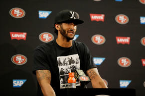 San Francisco 49ers quarterback Colin Kaepernick answers questions at a news con...