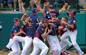 Endwell, N.Y. celebrates it's 2-1 win over South Korea in the Little League World Series Championship baseball game in South Williamsport, Pa., Sunday, Aug. 28, 2016.