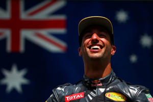 Daniel Ricciardo celebrates on the podium.