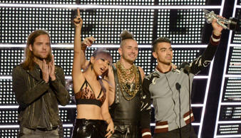 NEW YORK, NY - AUGUST 28: (L-R) Jack Lawless, JinJoo Lee, Cole Whittle and Joe Jonas of DNCE accept their award onstage during the 2016 MTV Video Music Awards at Madison Square Garden on August 28, 2016 in New York City. (Photo by Jeff Kravitz/FilmMagic)