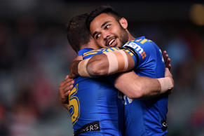 Bevan French (right) of the Eels is congratulated by Michael Gordon after scoring a try during the round 25 NRL match between the Parramatta Eels and the St George Illawarra Dragons at Pirtek Stadium in Sydney.