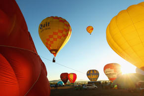 CANBERRA, AUSTRALIA - MARCH 10:  Balloons take-off in the Balloon Spectacular during Canberra Festival on March 10, 2012 in Canberra, Australia.  The annual balloon festival in Canberra is considered one of the best in the world, and is unique in allowin