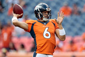Denver Broncos quarterback Mark Sanchez (6) warms up prior to the game against t...