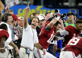 In this Dec. 31, 2015, file photo, Alabama head coach Nick Saban and team take t...