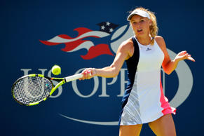 Caroline Wozniacki of Denmark returns a shot to Taylor Townsend of the United St...